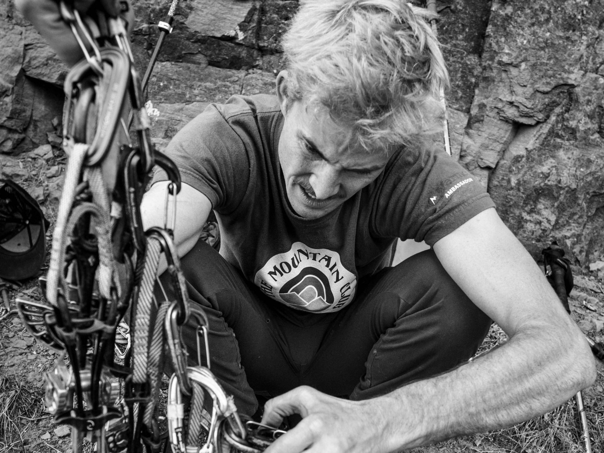 gentleman setting up rock climbing gear